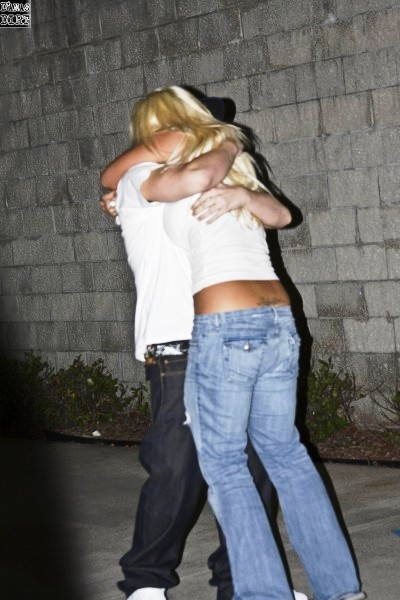 nick and brooke hogan hug upon nick's release