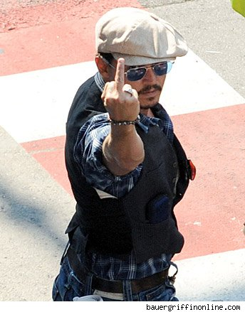 johnny depp gives photographers the middle finger