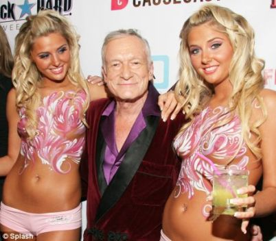 hugh hefner shannon twins split