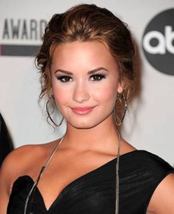 demi lovato enters rehab emotional problems