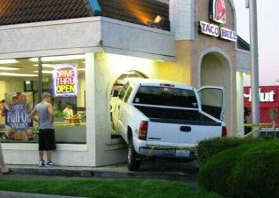 man drives truck through taco bell window