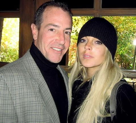 michael lohan charged with harrassment