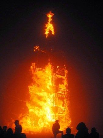 burning man man tower fire